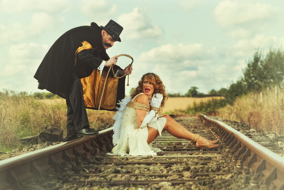 Damsel in Distress. Woman tied to train track by villain by Phil Jones Photography