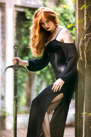 Fantasy image of redhead holding sword by Phil Jones Photography