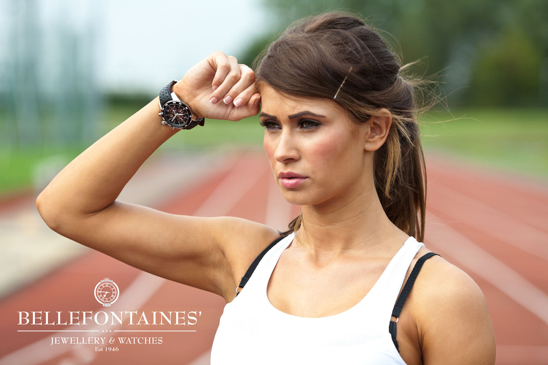 Strength and Beauty fitness photoshoot. Image of model Kelly Amber wearing her Seiko Sportura Watch inside her wrist whilst training on the track. Wearing your watch inside your wrist is a runners thing!