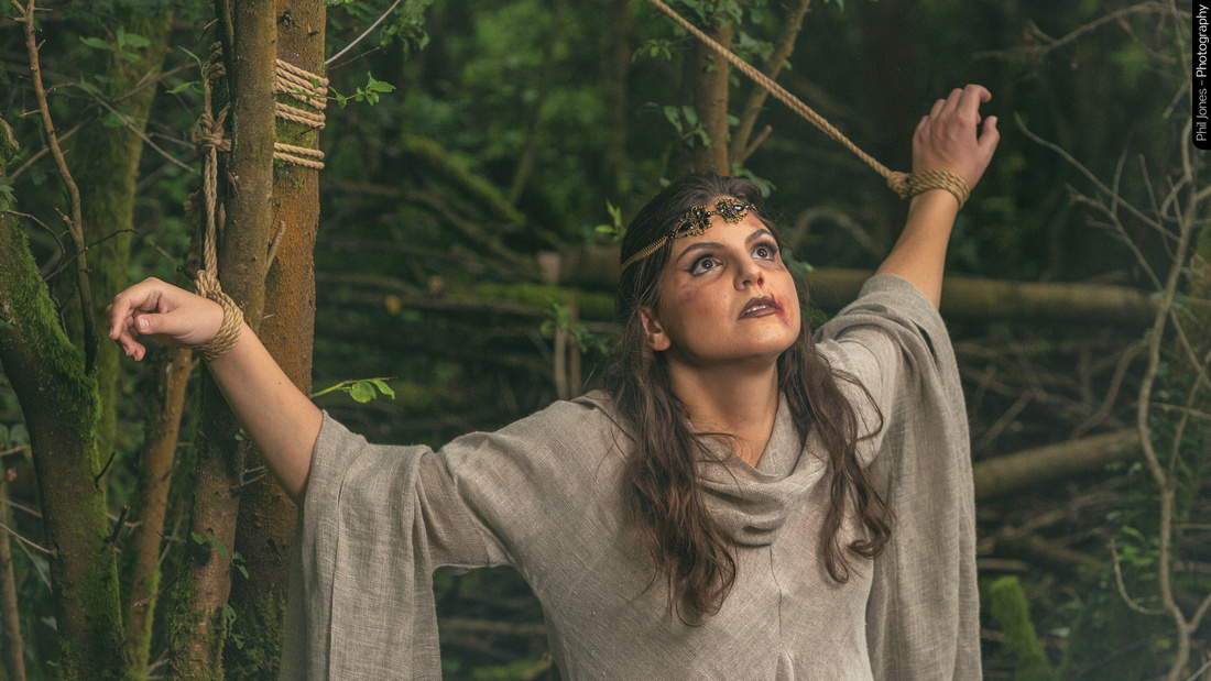 Tied and captive in the woods for a fantasy photoshoot by Phil Jones, make-up by Grace Gray