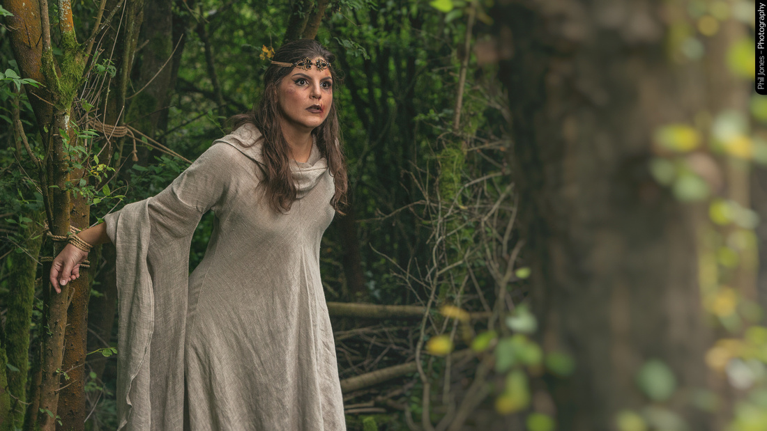 Actor Sara Cristy tied and captive in the woods for a fantasy role