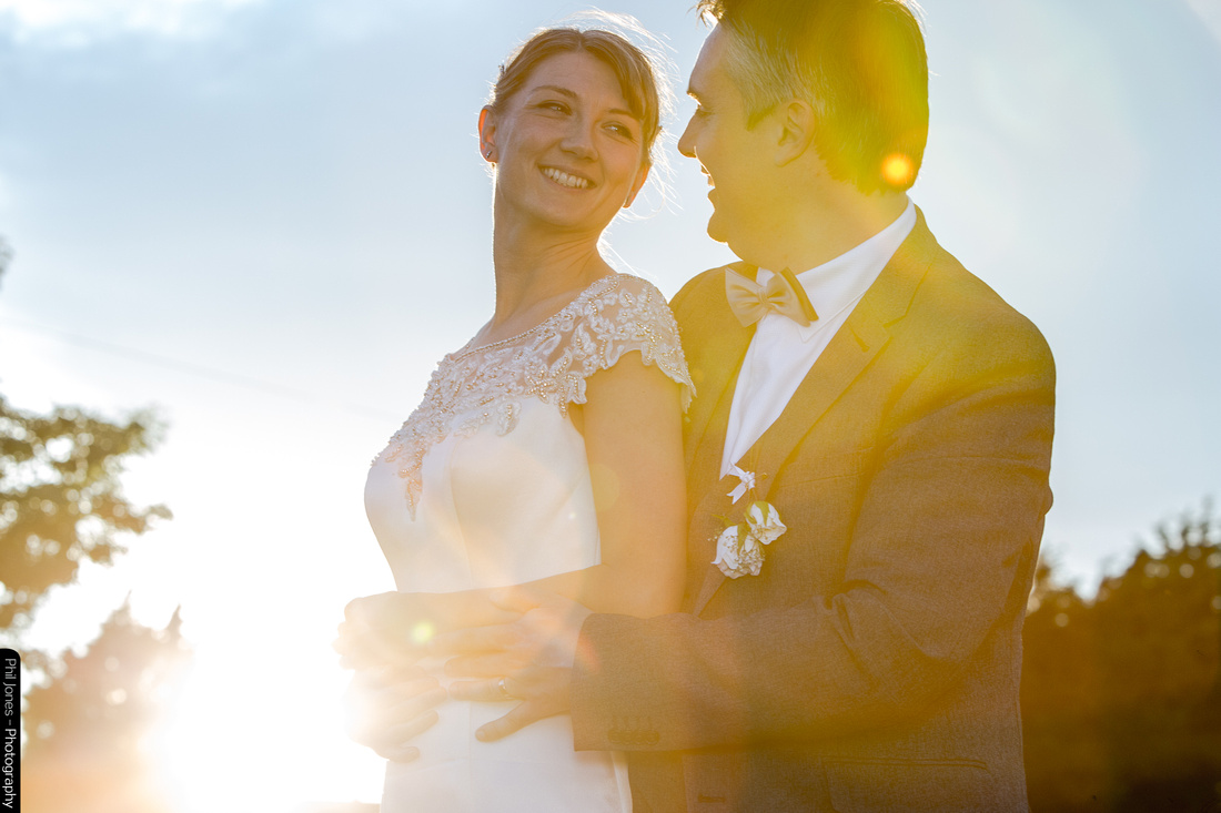 Sunset lights up wedding couple at Top Meadows, Essex