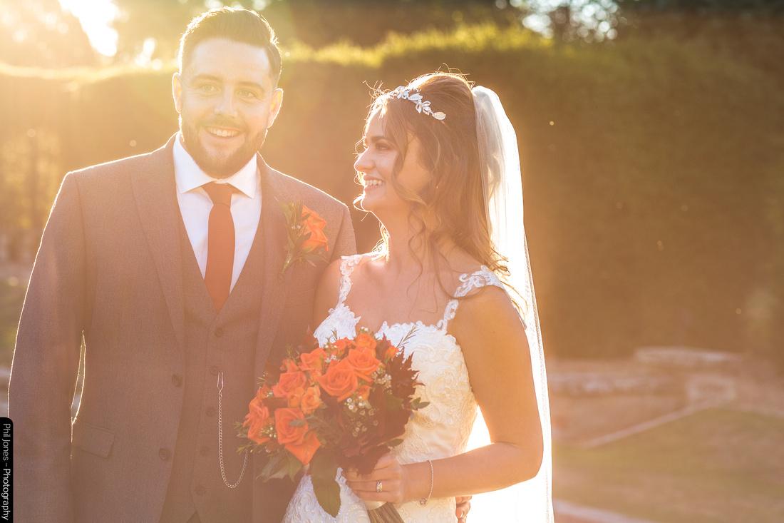 autumn sunset lights up wedding couple at Essex wedding