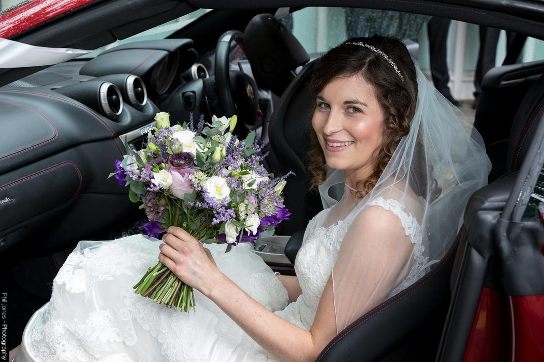 relaxed bride arrives at church in Ferrari