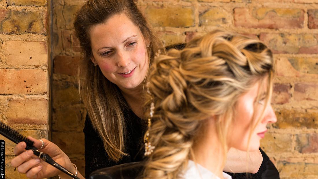 Hairstylist Wedding Hair by Tara at work during a bridal photoshoot