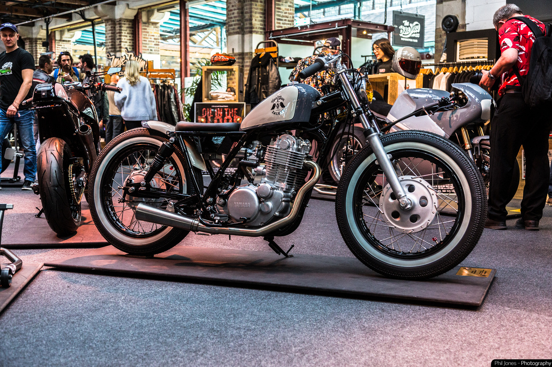 Two Gun Salute custom bobber built by Smith and Son Motorcycles. Yamaha SR400, Japanese style custom motorcycle.