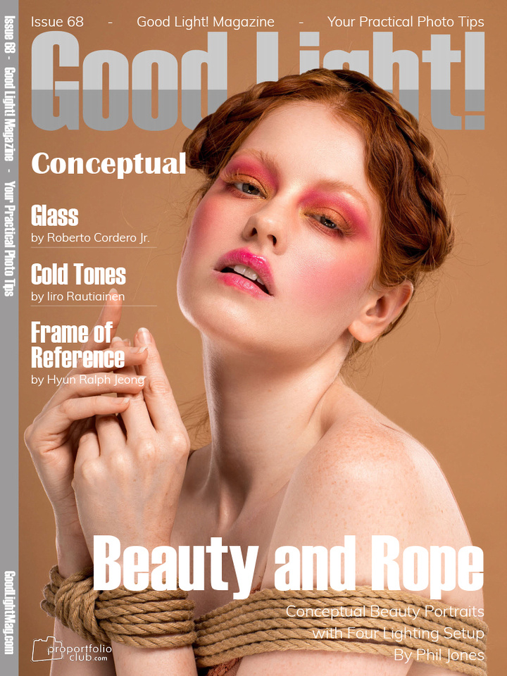 front cover of good light magazine with ginger hair model wearing bright makeup hands tied with rope