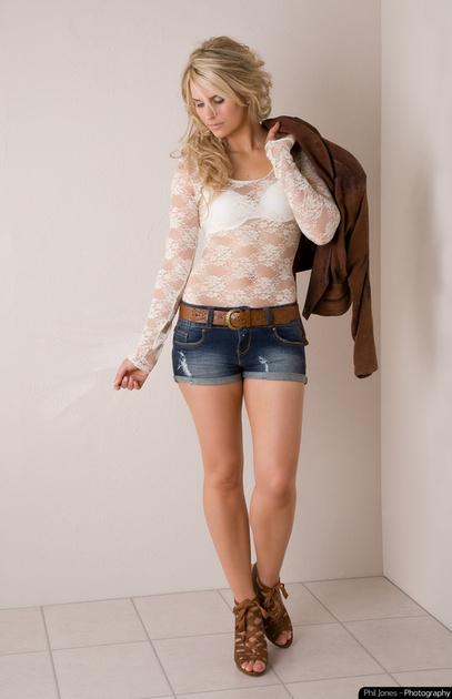 blonde model holding jacket over shoulder