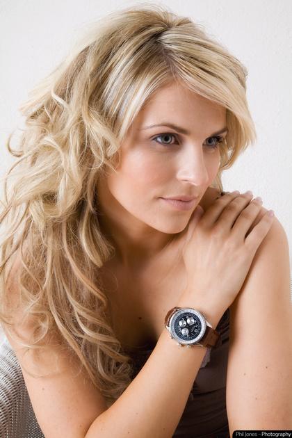 model wearing large face wrist watch
