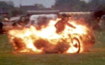 Phil stuntriding through Fire on his motorcycle