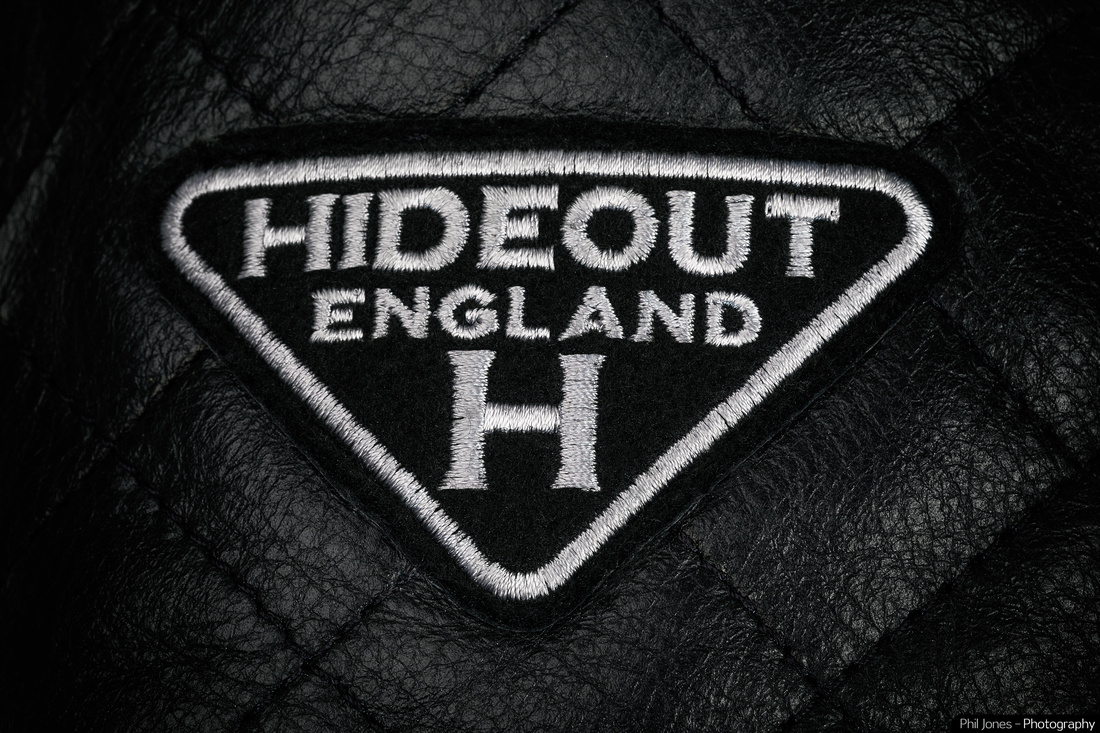 Photograph of Hideout Leather Brand logo on motorcycle jacket in black and white