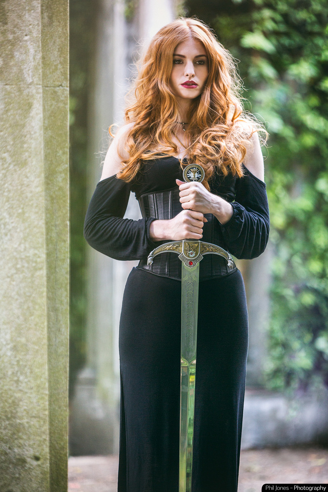 Shieldmaiden. Ginger female warrior with sword