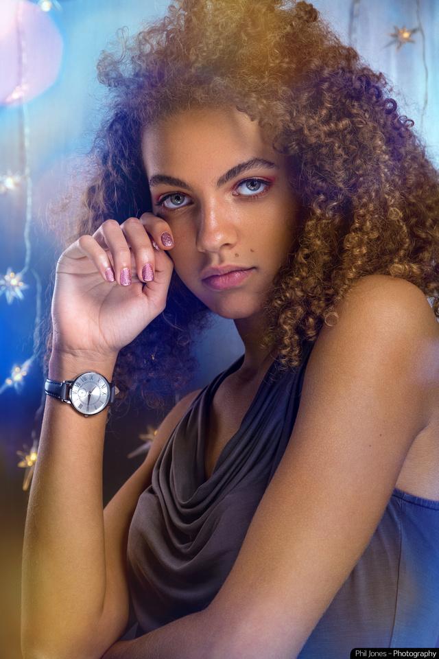 Yound model Ella Walker wearing New Look grey watch inside her wrist. Shot in home studio using Profoto B2 Location Kit