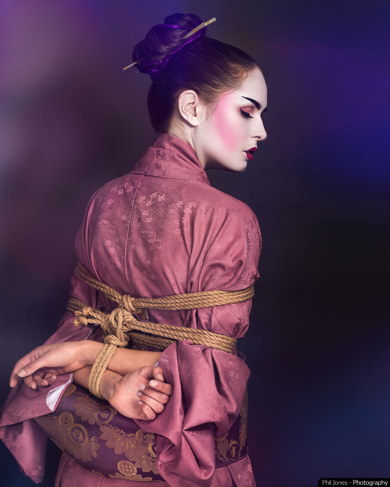 Geisha themed creative photoshoot with model tied with rope using takate kote which is a shibari tie