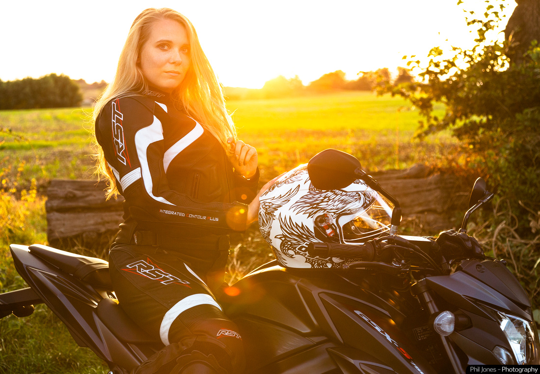 Motorcycle sunset photography. Sian Lacey wearing RST Leathers.