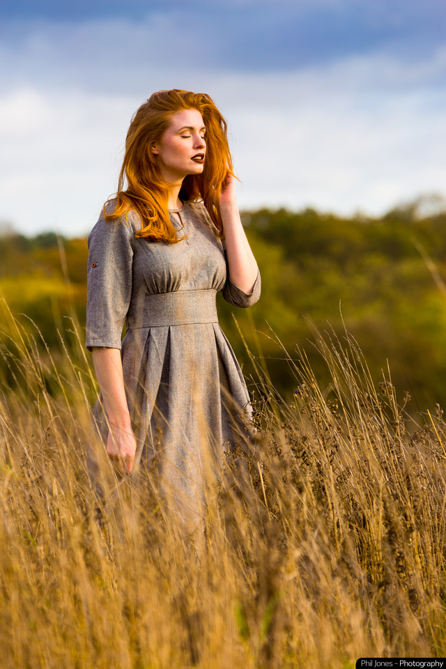 Model Grace Gray wearing Collectit Clothing. Bright sunshine on this Autumnal photoshoot. Model standing in tall grass