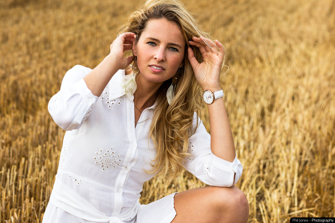 Boho fashion and watch photography. Model wearing Boho fashion and white watch inside her wrist. Model portfolio images by Phil Jones, Essex Photographer