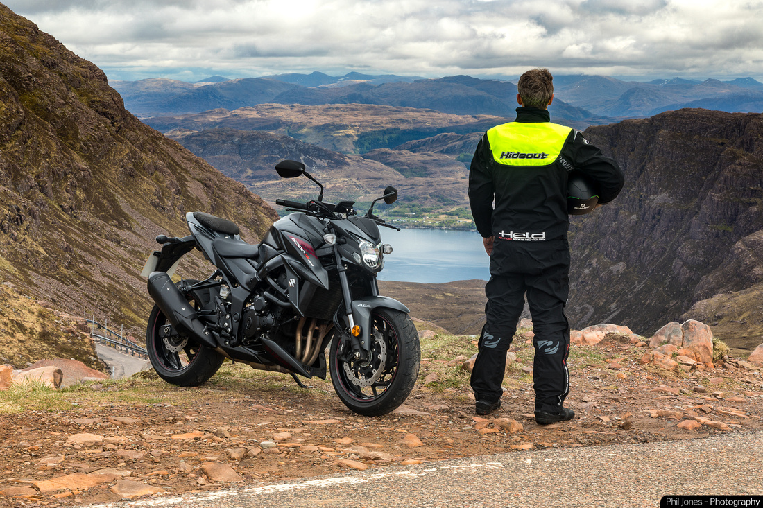 The Adventures of Phil Jones. Motorcyclist and photographer Phil Jones on Suzuki GSX S 750 at the Pass of the Cattle, Scotland