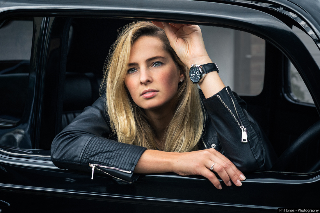 Beautiful blonde Model wearing Fossil Watch sitting in old Ford Popular HotRod