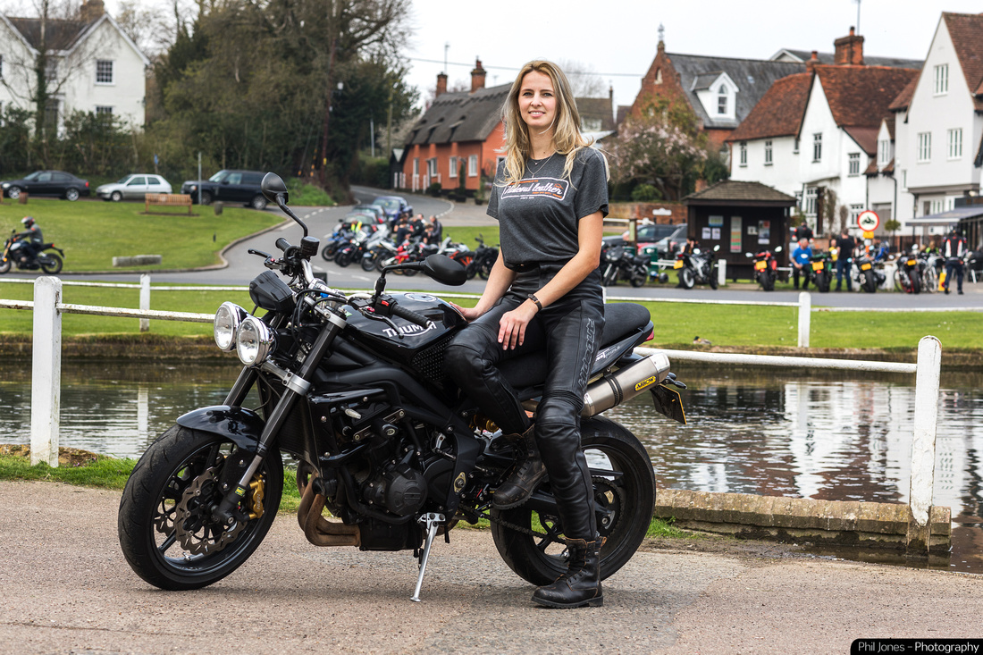 Triumph Street Triple 675. Lady biker wearing Hideout leather T-shirt at Finchingfield Essex