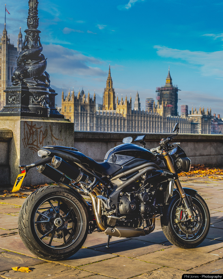 Triumph Speed Triple motorcycle in London by Houses of Parliament by Phil Jones Photography