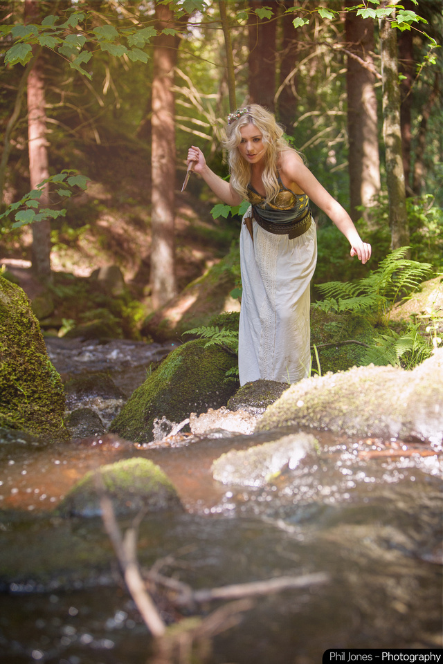 Female elf hunting for fish by brook - fantasy art photography by Phil Jones