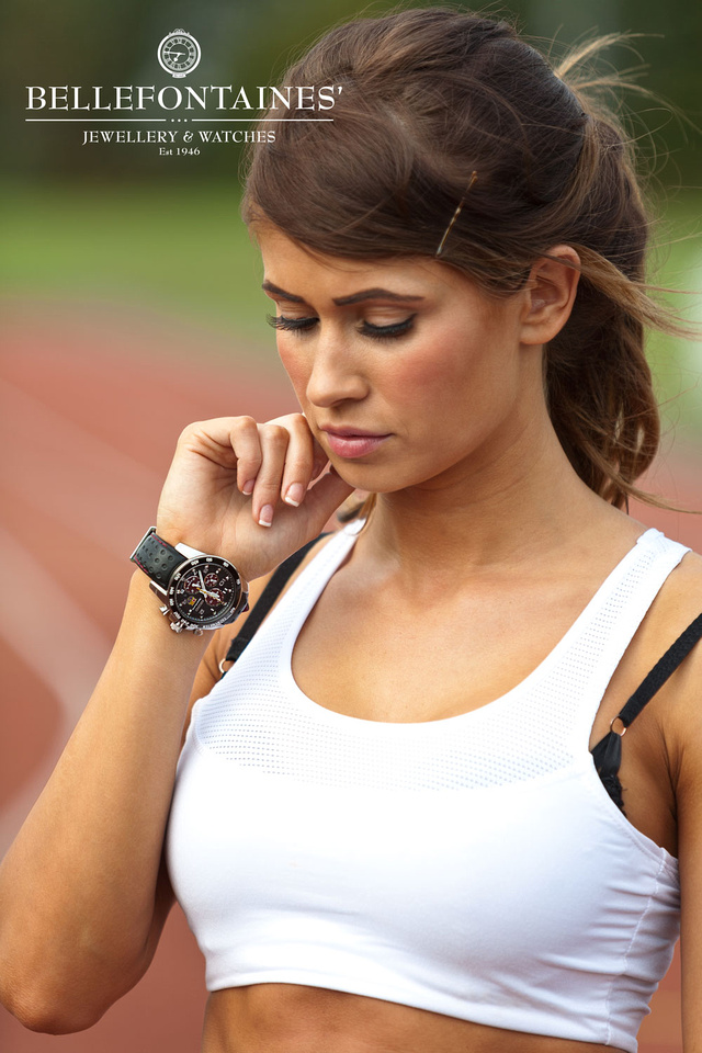 Model fitness photoshoot. Image of model Kelly Amber wearing her Seiko Sportura Watch whilst training on the running track. Wearing your watch inside your wrist is a runners thing and looks great on Kelly!