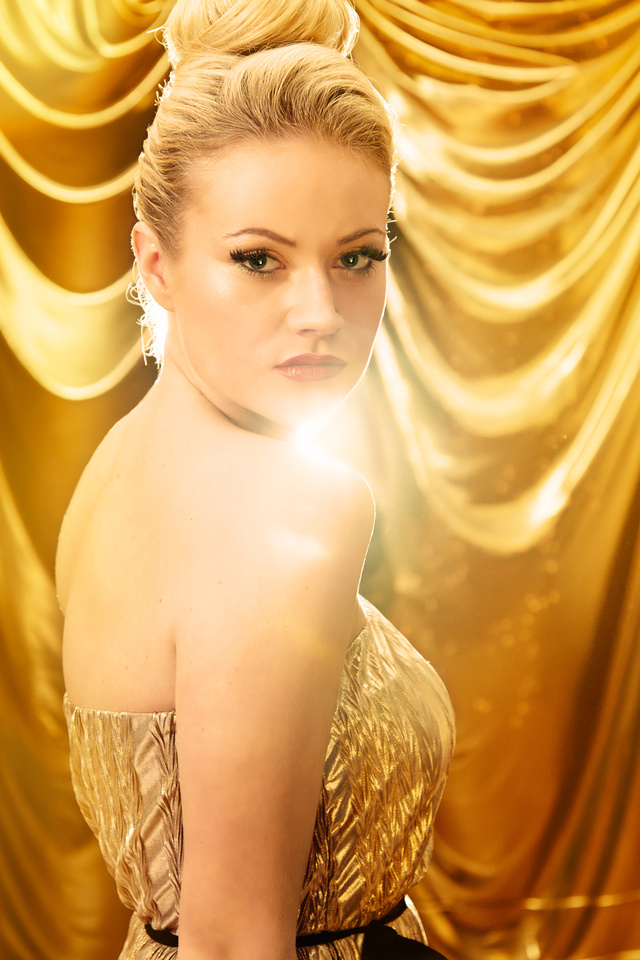Fashion shot of model against a gold background