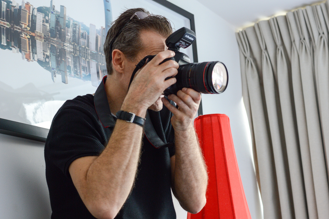 Behind the scenes shot of photographer Phil Jones using Canon 5D mkIV and Profoto B2 location kit